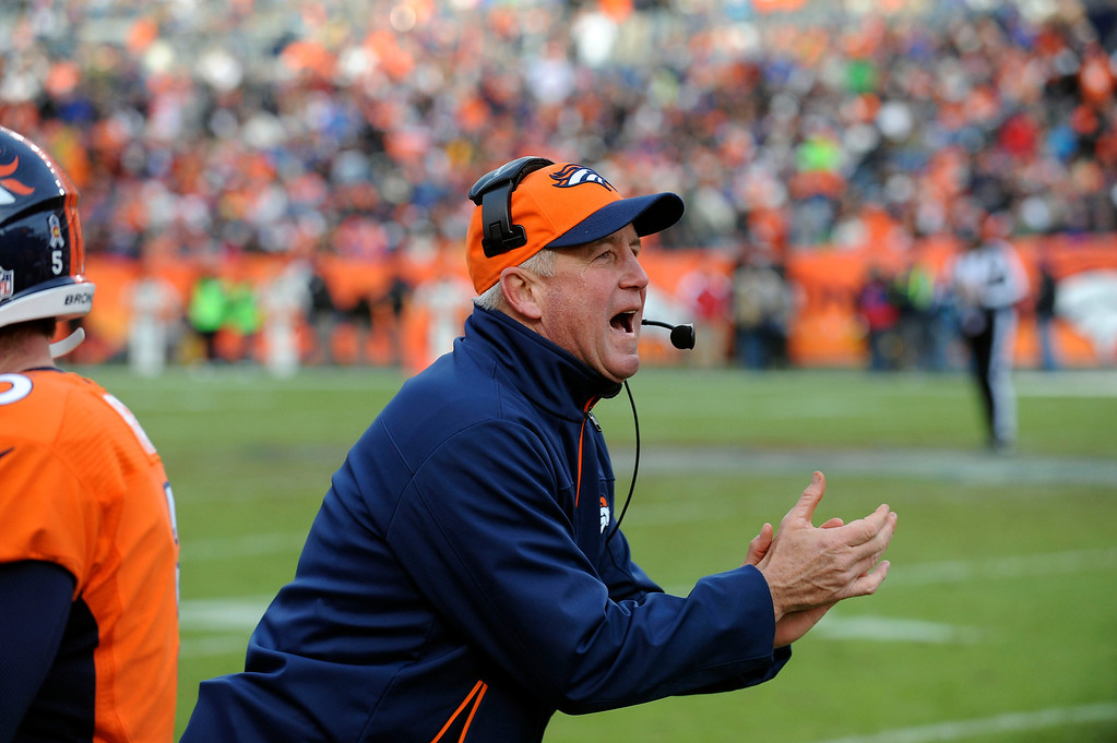 . Denver Broncos coach John Fox applauds the second touchdown in the game in the second quarter against Kansas City Sunday at Sports Authority Field. Steve Nehf, The Denver Post