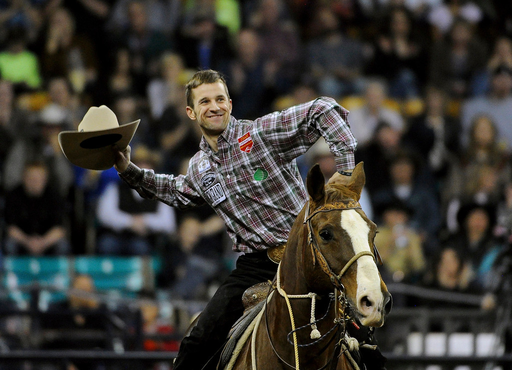 . DENVER, CO- JANUARY 27:   Shane Hanchey, of Sulphur, LA, who won the tie down roping event in the rodeo, gets ready to toss his cowboy hat in the air after his win.  He won the event.  The final day of the 2013 National Western Stock show was Sunday, January 27th.  One of the big events for the day was the PRCA Pro Rodeo finals in the Coliseum.  The event featured bareback riding, steer wrestling, team roping, saddle bronc riding, tie down roping, barrel racing and bull riding.  (Photo By Helen H. Richardson/ The Denver Post)