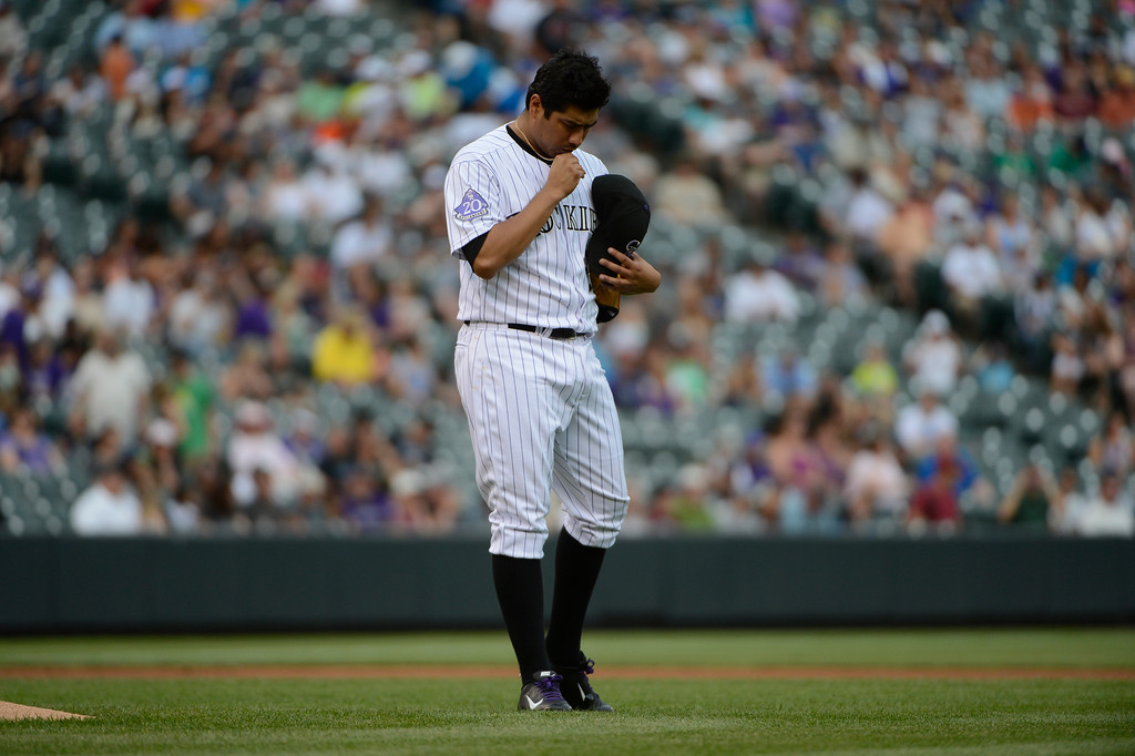 . DENVER, CO - JUNE 27: Colorado Rockies pitcher, Jorge De La Rosa kisses his cross on a necklace just before starting against the San Francisco Giants at Coors Field Saturday afternoon, June 29, 2013. (Photo By Andy Cross/The Denver Post)