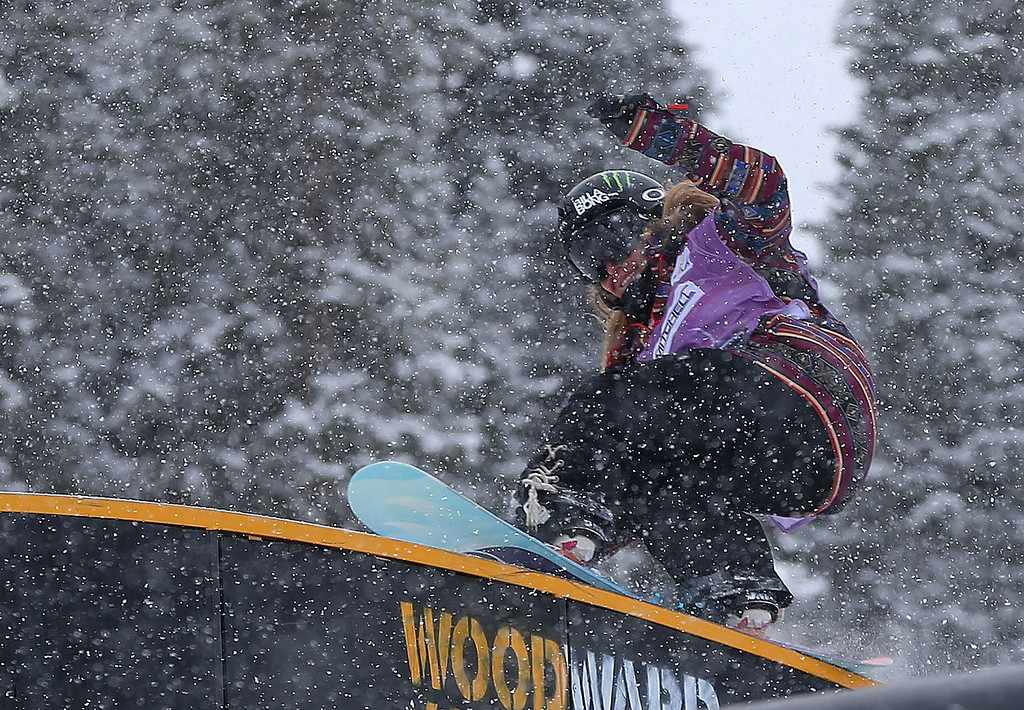. Jamie Anderson competes during qualifying for the women\'s FIS Snowboard Slopestyle World Cup at U.S. Snowboarding and Freeskiing Grand Prix on December 20, 2013 in Copper Mountain, Colorado.  (Photo by Mike Ehrmann/Getty Images)