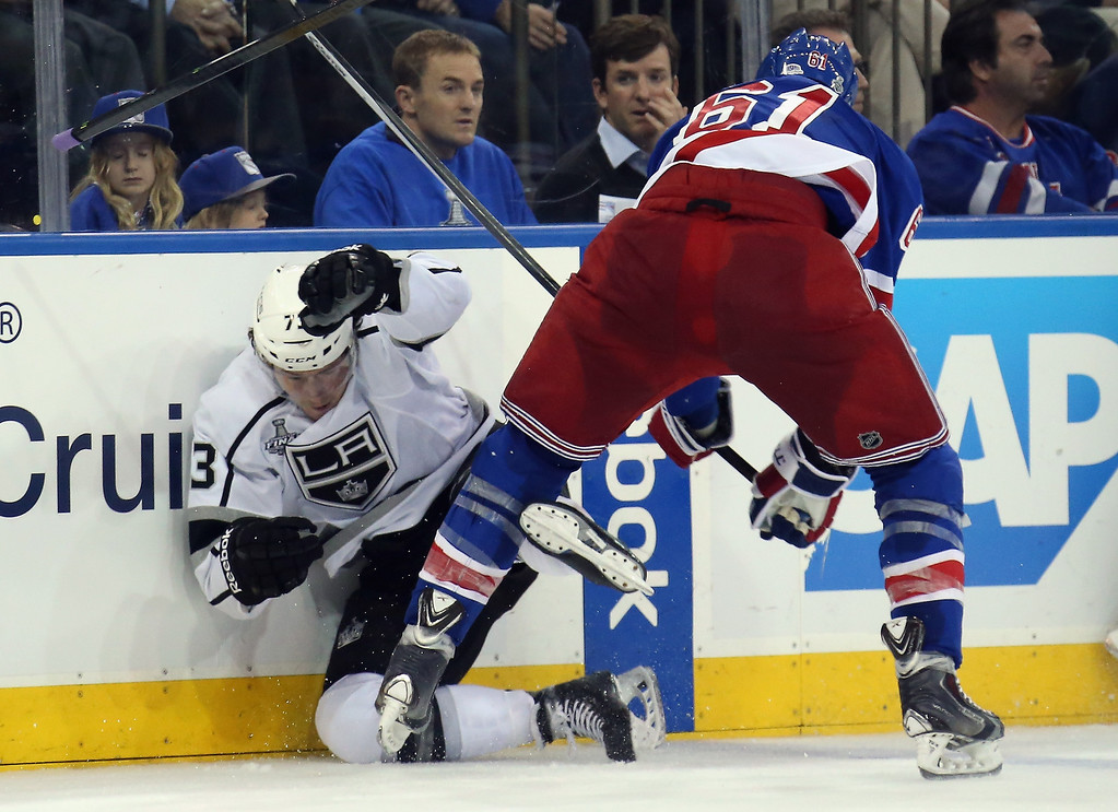 . Rick Nash #61 of the New York Rangers checks Tyler Toffoli #73 of the Los Angeles Kings during the second period of Game Three of the 2014 NHL Stanley Cup Final at Madison Square Garden on June 9, 2014 in New York, New York.  (Photo by Bruce Bennett/Getty Images)