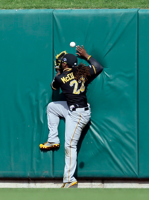 . Pittsburgh Pirates center fielder Andrew McCutchen hits the wall as he fails to catch a double by St. Louis Cardinals\' Matt Adams in the ninth inning of Game 2 of baseball\'s National League division series on Friday, Oct. 4, 2013, in St. Louis. The Pirates won 7-1. (AP Photo/Jeff Roberson)