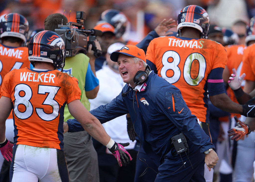 . Denver Broncos wide receiver Wes Welker (83) is congratulated by Denver Broncos head coach John Fox in the third quarter. (Photo by Joe Amon/The Denver Post)