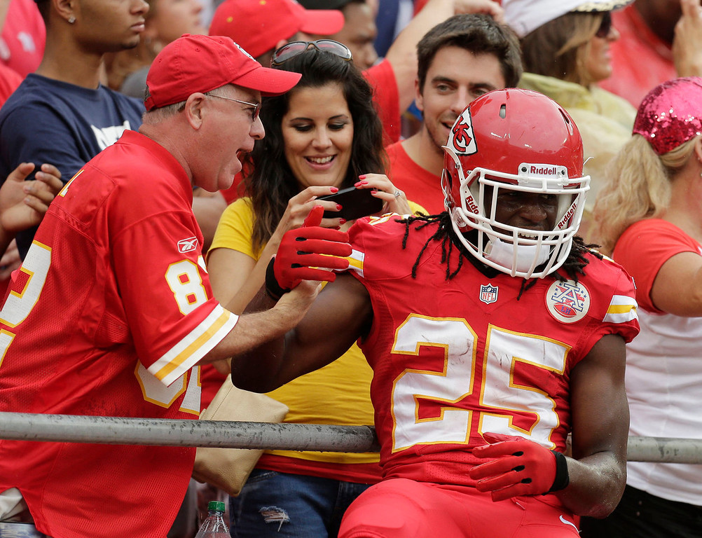 . Kansas City Chiefs running back Jamaal Charles (25) celebrates a touchdown with fans during the first half of an NFL football game against the Dallas Cowboys at Arrowhead Stadium in Kansas City, Mo., Sunday, Sept. 15, 2013. (AP Photo/Charlie Riedel)