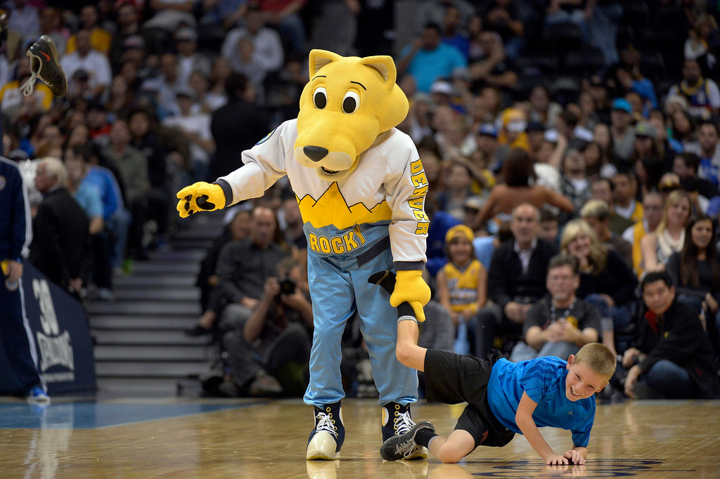 . DENVER, CO - NOVEMBER 13: Denver Nuggets team mascot Rocky tosses a shoe from a young fan during a timeout in the fourth quarter against the Los Angeles Lakers November 13, 2013 at Pepsi Center. (Photo by John Leyba/The Denver Post)