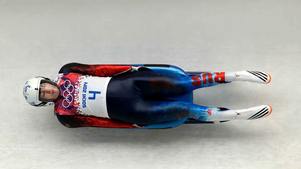 . Tatyana Ivanova of Russia speeds down the track in her first run during the women\'s singles luge competition at the 2014 Winter Olympics, Monday, Feb. 10, 2014, in Krasnaya Polyana, Russia. (AP Photo/Michael Sohn)