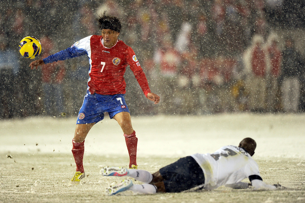 . COMMERCE CITY, CO - MARCH 22: Costa Rica midfielder Cristian Bolanos (7) eyes the ball after United States midfielder DaMarcus Beasley (7) falls to the ground during a FIFA 2014 World Cup Qualifier game at Dick\'s Sporting Goods Park on March 22, 2013, in Commerce City, Colorado. The United States won 1-0. (Photo by Daniel Petty/The Denver Post)