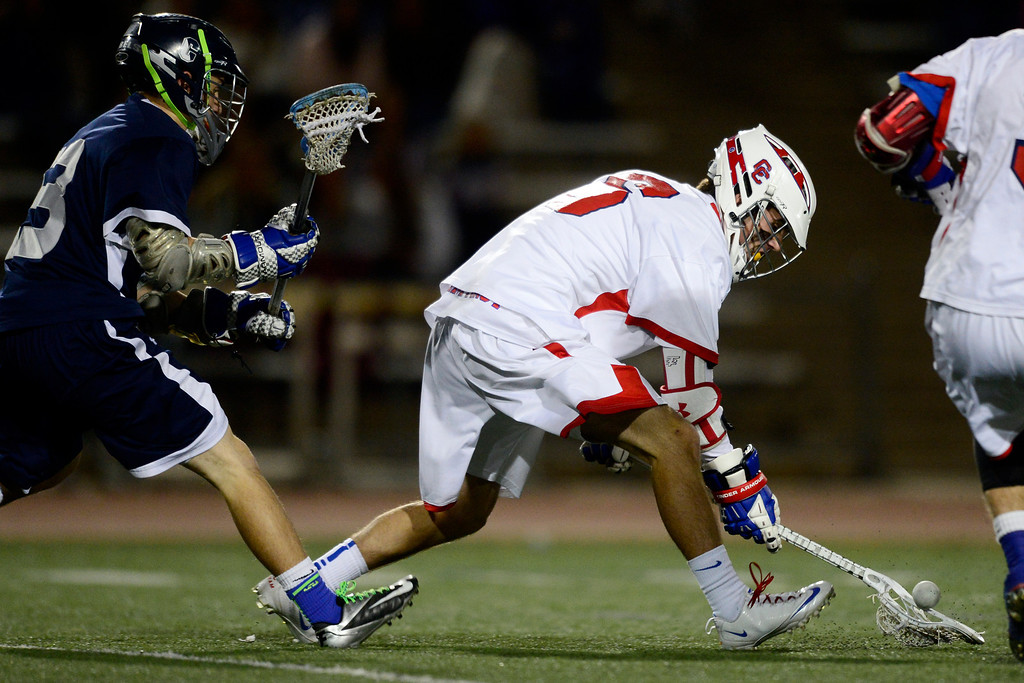 . Cherry Creek\'s Julian Schwab wrangles a loose ball during Cherry Creek\'s 7-6 win.  (Photo by AAron Ontiveroz/The Denver Post)