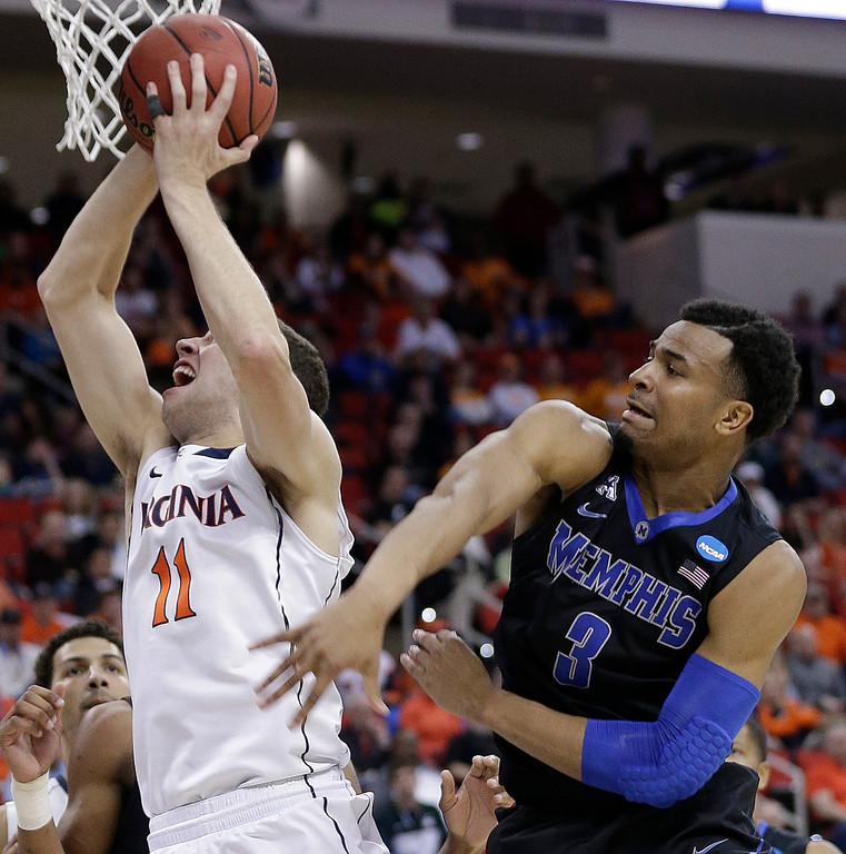 . Virginia forward Evan Nolte (11) shoots against Memphis guard Chris Crawford (3) during the second half of an NCAA college basketball third-round tournament game, Sunday, March 23, 2014, in Raleigh, N.C. (AP Photo/Chuck Burton)