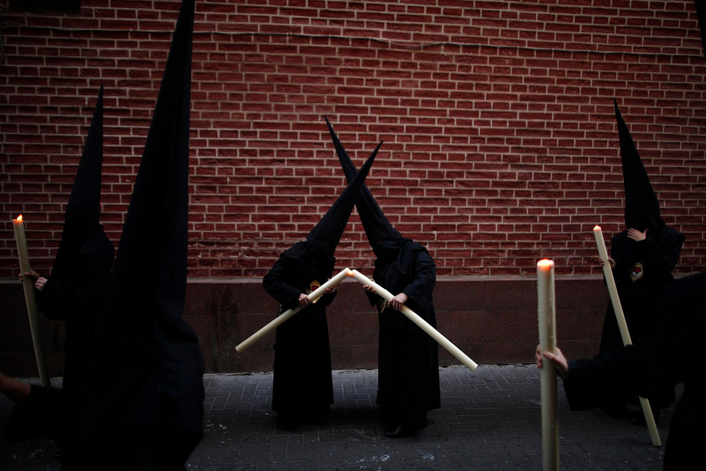 . Penitents light their candles as they take part in the Calvario brotherhood procession during Holy Week in Malaga, southern Spain, April 6, 2012. Hundreds of processions take place around the clock in Spain during Holy Week, drawing thousands of visitors. Picture taken April 6, 2012. REUTERS/Jon Nazca