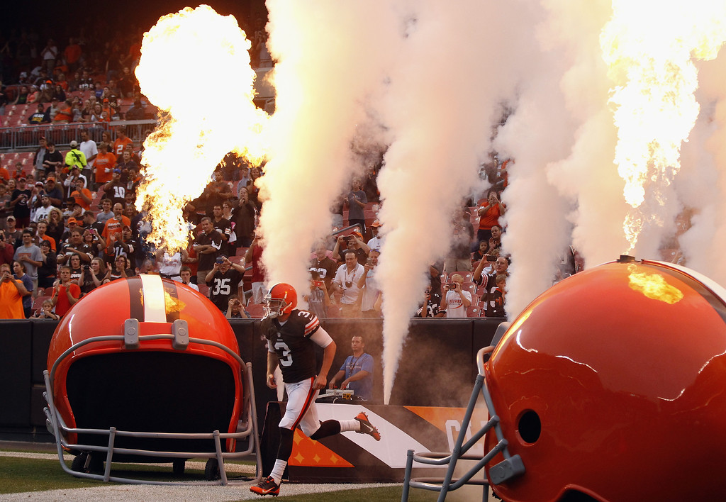 . CLEVELAND, OH - AUGUST 08:  Quarterback Brandon Weeden #3 of the Cleveland Browns runs onto the field before the start of their game against the St. Louis Rams at FirstEnergy Stadium on August 8, 2013 in Cleveland, Ohio.  (Photo by Matt Sullivan/Getty Images)