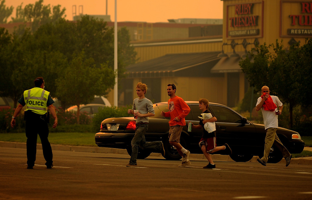 . Colorado Springs Police officers direct traffic and secure the corner of Garden of Gods Rd. and Centennial Blvd. in Colorado Springs, Colo, Tuesday, June 26. Hyoung Chang, The Denver Post