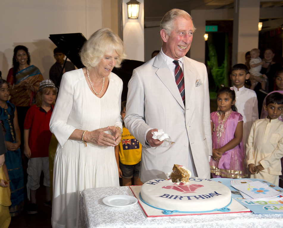 . Prince Charles, Prince of Wales cuts his 65th Birthday cake as Camilla, Duchess of Cornwall looks on during a reception at the British High Commission on November 14, 2013 in Colombo, Sri Lanka. The Royal couple are visiting Sri Lanka in order to attend the 2013 Commonwealth Heads of Government Meeting.  (Photo by Arthur Edwards -  Pool/Getty Images)