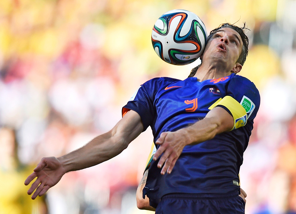 . Netherlands\' Robin van Persie controls the ball during the group B World Cup soccer match between Australia and the Netherlands at the Estadio Beira-Rio in Porto Alegre, Brazil, Wednesday, June 18, 2014.  (AP Photo/Martin Meissner)