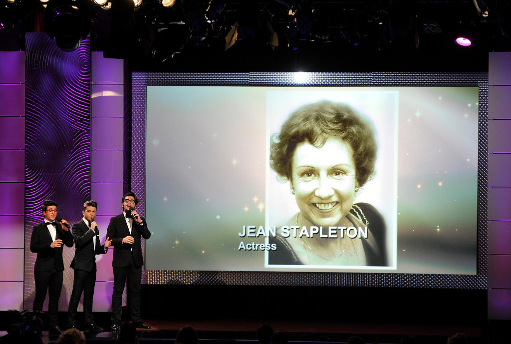 . Piero Barone, from left, Gianluca Ginoble and Ignazio Boschetto, of the musical group Il Volo, perform during an in memoriam tribute at the 40th Annual Daytime Emmy Awards on Sunday, June 16, 2013, in Beverly Hills, Calif. Pictured on screen is Jean Stapleton. (Photo by Chris Pizzello/Invision/AP)