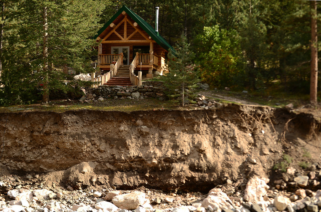 . Some homes are completely inaccessible along Highway 34  near Drake, Co on October 16, 2013. While the ultimate goal is to provide a  temporary roadway that permits travel between Estes Park and Loveland, crews initially wanted to provide access to residents who needed to retrieve belongings and winterize their homes in the area.    (Photo By Helen H. Richardson/ The Denver Post)