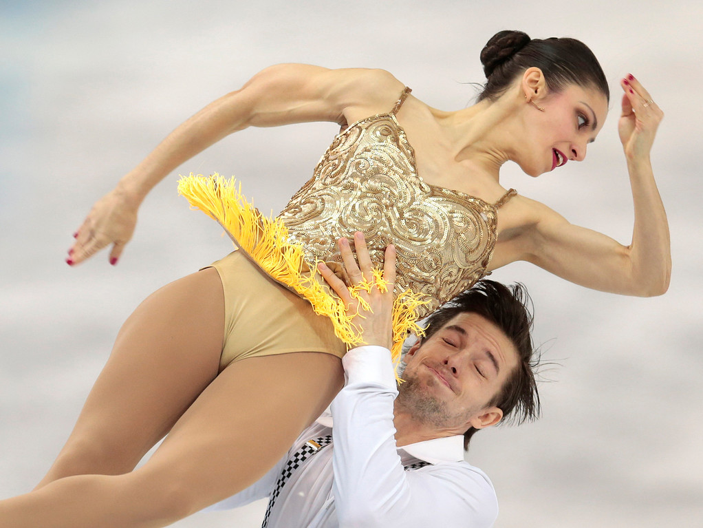 Description of . Stefania Berton and Ondrej Hotarek of Italy compete in the pairs short program figure skating competition at the Iceberg Skating Palace during the 2014 Winter Olympics, Tuesday, Feb. 11, 2014, in Sochi, Russia. (AP Photo/Ivan Sekretarev)