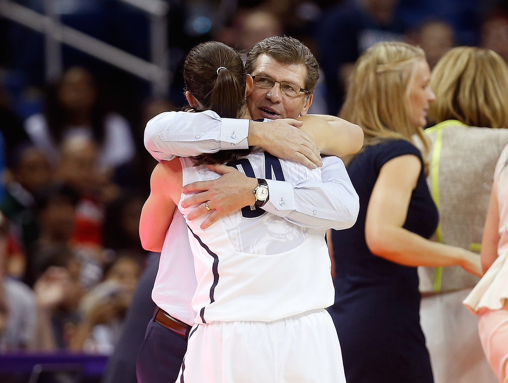 . Head coach Geno Auriemma of the Connecticut Huskies hugs Kelly Faris #34 as she exits the game in the second half against the Louisville Cardinals during the 2013 NCAA Women\'s Final Four Championship at New Orleans Arena on April 9, 2013 in New Orleans, Louisiana.  (Photo by Chris Graythen/Getty Images)