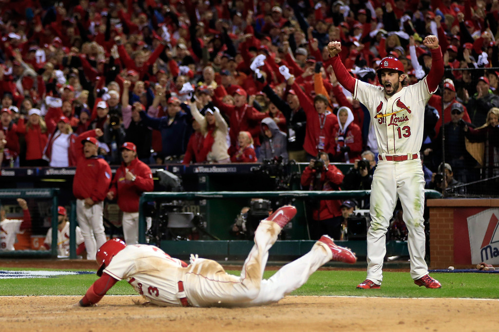 . ST LOUIS, MO - OCTOBER 26:  Carlos Beltran #3 of the St. Louis Cardinals and Matt Carpenter #13 celebrate as they score on a double by Matt Holliday #7 in the seventh inning against the Boston Red Sox during Game Three of the 2013 World Series at Busch Stadium on October 26, 2013 in St Louis, Missouri.  (Photo by Jamie Squire/Getty Images)