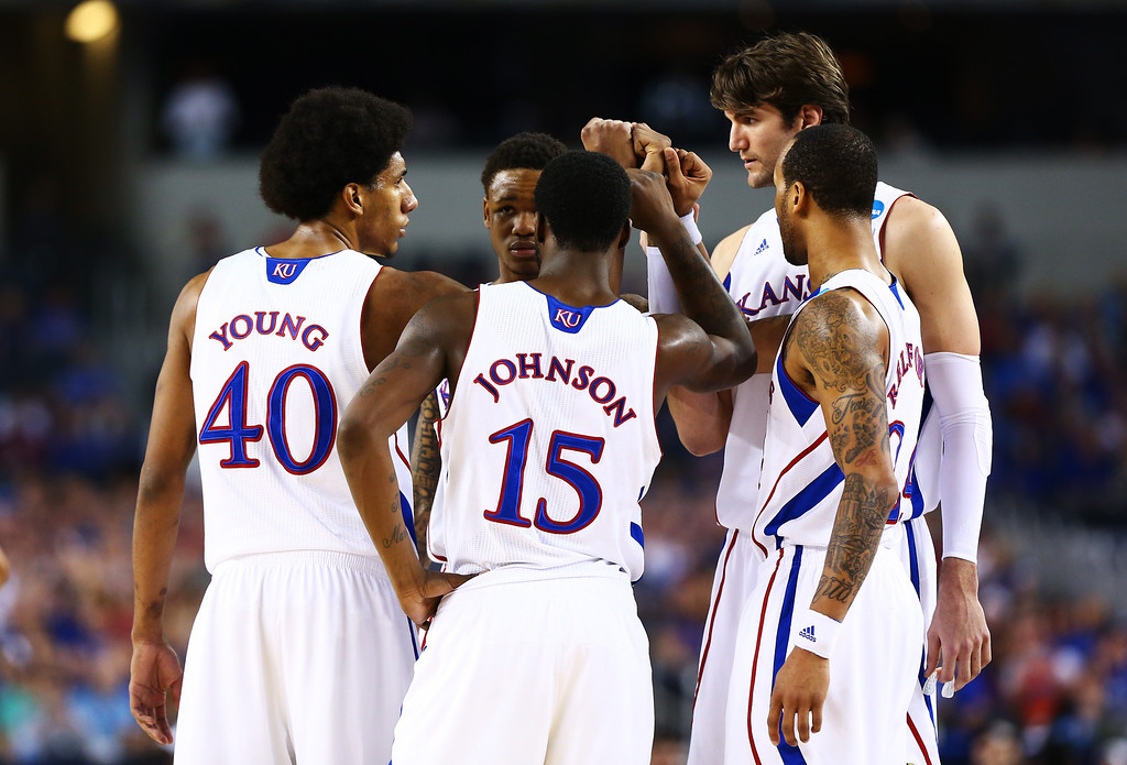 . ARLINGTON, TX - MARCH 29:  The Kansas Jayhawks huddle in the first half against the Michigan Wolverines during the South Regional Semifinal round of the 2013 NCAA Men\'s Basketball Tournament at Dallas Cowboys Stadium on March 29, 2013 in Arlington, Texas.  (Photo by Tom Pennington/Getty Images)