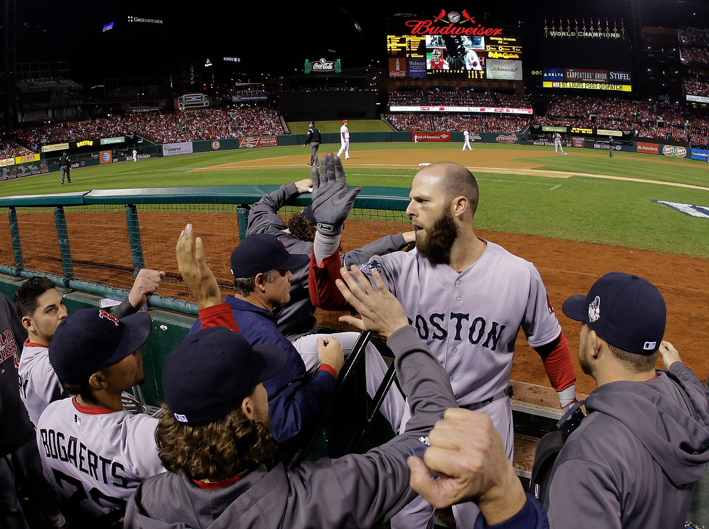 . Boston Red Sox second baseman Dustin Pedroia scores on an RBI double by Boston Red Sox designated hitter David Ortiz during the first inning of Game 5 of baseball\'s World Series Monday, Oct. 28, 2013, in St. Louis. (AP Photo/Matt Slocum)
