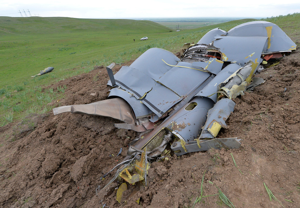 . Wreckage from a U.S. Air Force KC-135 tanker aircraft wreckage is strewn across a field near the village of Chaldovar, about 100 miles (160 kms) west of the Kyrgyz capital Bishkek, Friday, May 3, 2013. The emergencies ministry in Kyrgyzstan says a US military plane has crashed in the country. Kyrgyzstan hosts a US base that is used for troops transiting into and out of Afghanistan and for C-135 tanker planes that refuel warplanes in flight. (AP Photo/Vladimir Voronin)