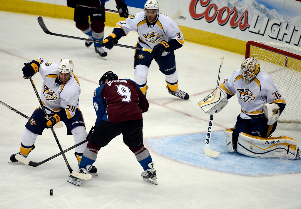 . Colorado Avalanche center Matt Duchene (9) and Nashville Predators left wing Eric Nystrom (24) battle for the puck in from of Nashville Predators goalie Carter Hutton (30) during the second period November 6, 2013 at Pepsi Center. (Photo by John Leyba/The Denver Post)