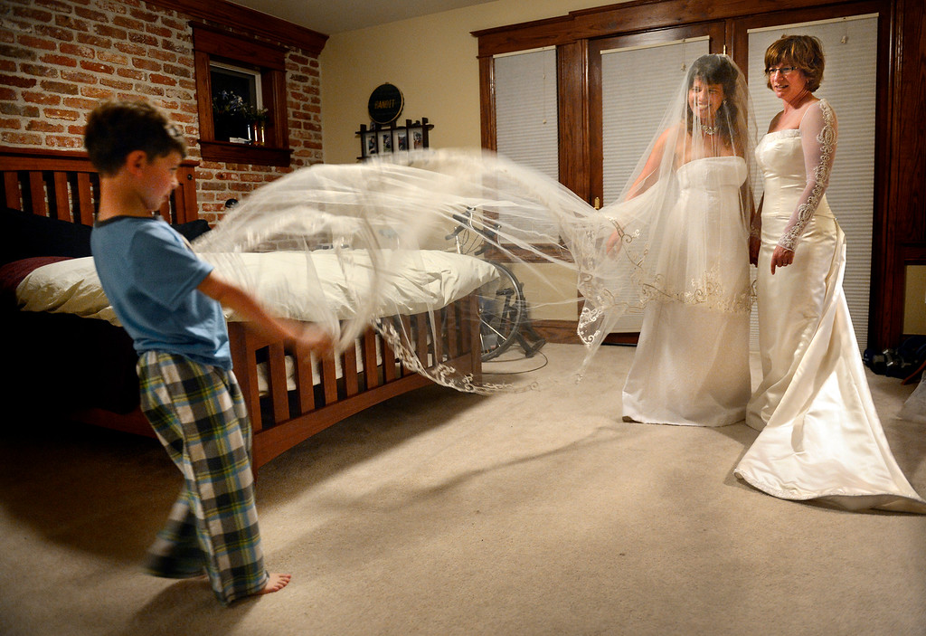 . Fran and Anna Simon try on their wedding dresses with help from their 5-year-old son, Jeremy, at their home in Denver. The couple, who were hoping to be one of the first in Colorado to be joined in a civil union, has been together 10 years and wore the same dresses in 2005 when they had a commitment ceremony at the Denver Botanic Gardens.