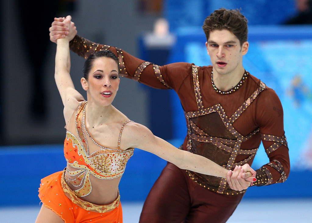 Description of . Nicole Della Monica and Matteo Guarise of Italy compete during the Figure Skating Pairs Short Program on day four of the Sochi 2014 Winter Olympics at Iceberg Skating Palace on February 11, 2014 in Sochi, Russia.  (Photo by Paul Gilham/Getty Images)
