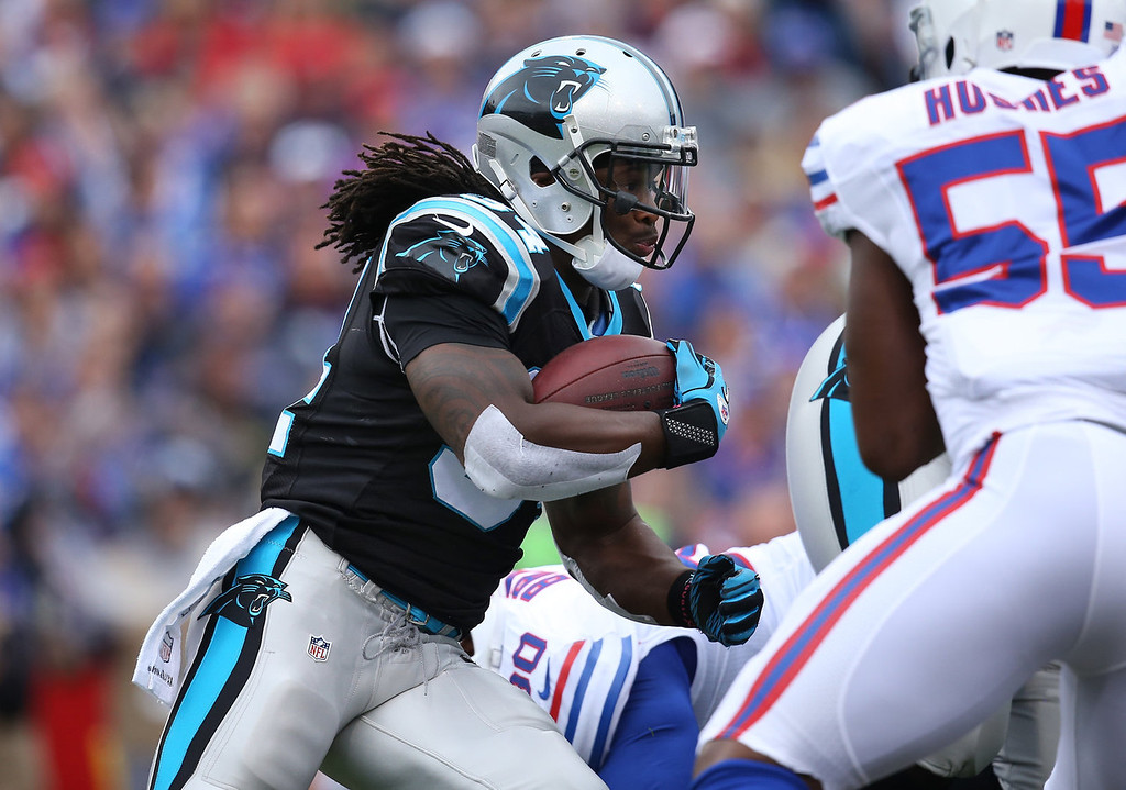 . DeAngelo Williams #34 of the Carolina Panthers carries the ball during NFL game action against the Buffalo Bills at Ralph Wilson Stadium on September 15, 2013 in Orchard Park, New York. (Photo by Tom Szczerbowski/Getty Images)