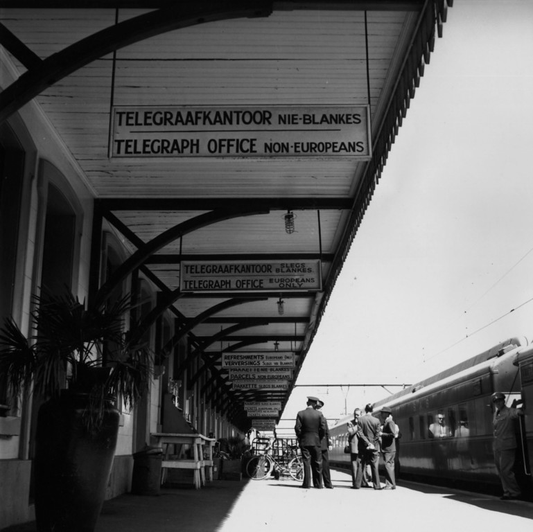 . circa 1955:  Signs in English and Afrikaans, in Wellington railway station, South Africa, enforcing the policy of apartheid or racial segregation.  (Photo by Evans/Three Lions/Getty Images)