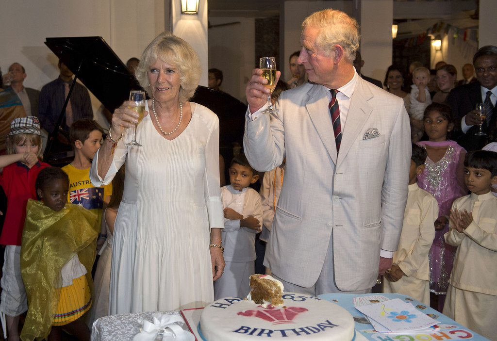 . Prince Charles, Prince of Wales and Camilla, Duchess of Cornwall raise their glasses after cutting his 65th Birthday cake during a reception at the British High Commission on November 14, 2013 in Colombo, Sri Lanka.   (Photo by Arthur Edwards -  Pool/Getty Images)