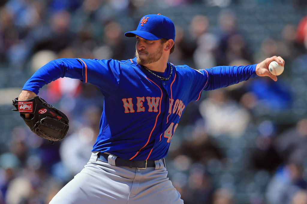 . Starting pitcher Jonathon Niese #49 of the New York Mets delivers against the Colorado Rockies at Coors Field on April 18, 2013 in Denver, Colorado.  (Photo by Doug Pensinger/Getty Images)