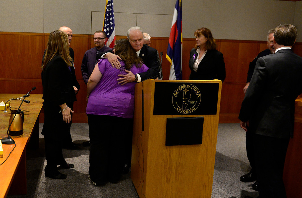 . District Attorney Peter Weir and Jessica Ridgeway\'s mother Sarah Ridgeway, embrace after a news conference in district court in Golden, November 19, 2013. The news conference was held in the courtroom where District Judge Stephen Munsinger had just sentenced 18-year-old Austin Sigg to life plus 86 years for Jessica Ridgeway\'s murder. (Photo by RJ Sangosti/The Denver Post)