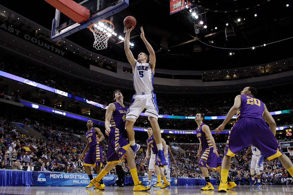 . Duke\'s Mason Plumlee (5) goes up for a shot against Albany\'s John Puk (44) during the first half of a second-round game of the NCAA college basketball tournament, Friday, March 22, 2013, in Philadelphia. (AP Photo/Matt Slocum)