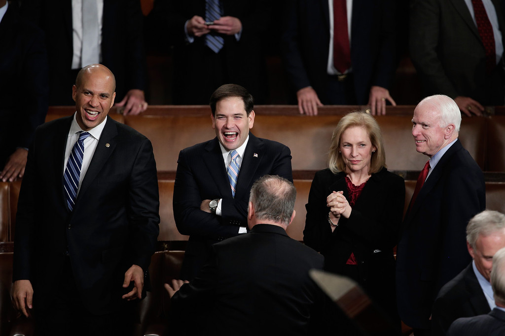 . WASHINGTON, DC - JANUARY 28: (L-R) U.S. Sen. Cory Booker (D-NJ), U.S. Sen. Marco Rubio (R-FL), U.S. Sen. Kristen Gillibrand (D-NY) , and U.S. Sen. John McCain (R-AZ) wait for U.S. President Barack Obama to deliver the State of the Union address to a joint session of Congress in the House Chamber at the U.S. Capitol on January 28, 2014 in Washington, DC. In his fifth State of the Union address, Obama is expected to emphasize on healthcare, economic fairness and new initiatives designed to stimulate the U.S. economy with bipartisan cooperation.  (Photo by Win McNamee/Getty Images)