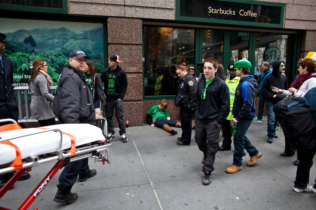 . An emergency crew responds to a woman during the 252nd annual St. Patrick\'s Day Parade March 16, 2013 in New York City. The parade honors the patron saint of Ireland and was held for the first time in New York on March 17, 1762, 14 years before the signing of the Declaration of Independence. (Photo by Ramin Talaie/Getty Images)