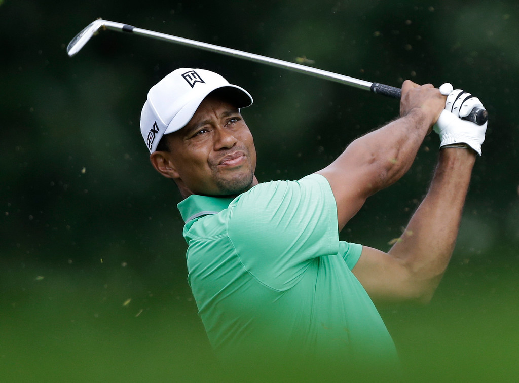 . Tiger Woods watches his tee shot on the sixth hole during the second round of the PGA Championship golf tournament at Oak Hill Country Club, Friday, Aug. 9, 2013, in Pittsford, N.Y. (AP Photo/Julio Cortez)