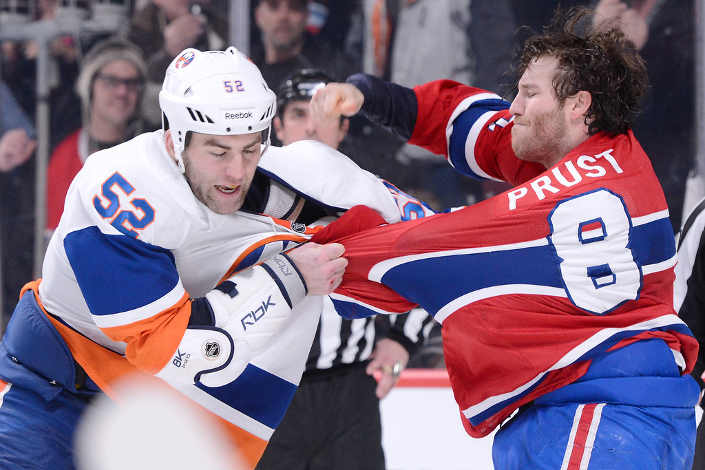 . MONTREAL, CANADA - FEBRUARY 21:  Brandon Prust #8 of the Montreal Canadiens throws a punch at Joe Finley #52 of the New York Islanders during the NHL game at the Bell Centre on February 21, 2013 in Montreal, Quebec, Canada.  (Photo by Richard Wolowicz/Getty Images)
