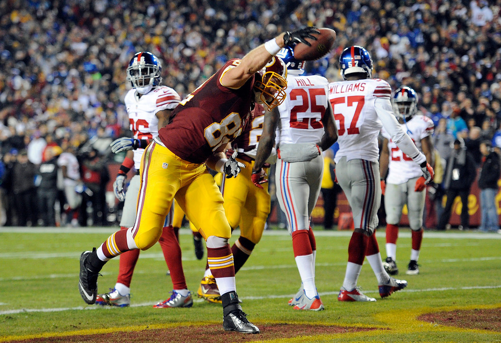 . Washington Redskins tight end Logan Paulsen (82) spikes the football after his touchdown during the first half of an NFL football game against the New York Giants Sunday, Dec. 1, 2013, in Landover, Md. (AP Photo/Nick Wass)
