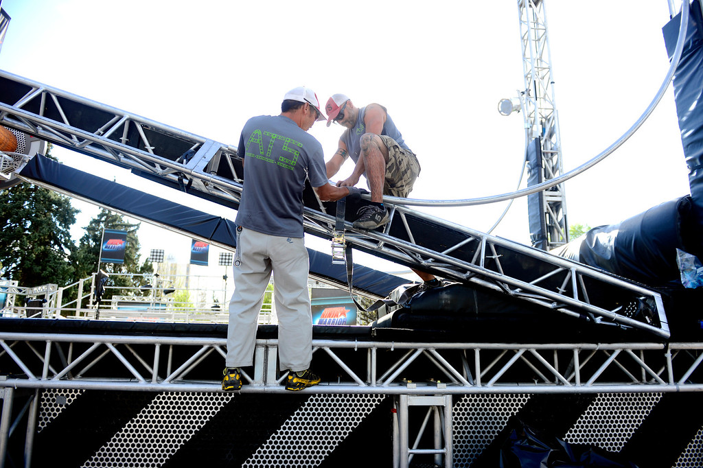 . Kevin Wakashige (left) and Johnnie Braden construct the rolling log before the tryout for American Ninja Warrior Denver on on May 19, 2013. (Photo by AAron Ontiveroz/The Denver Post)