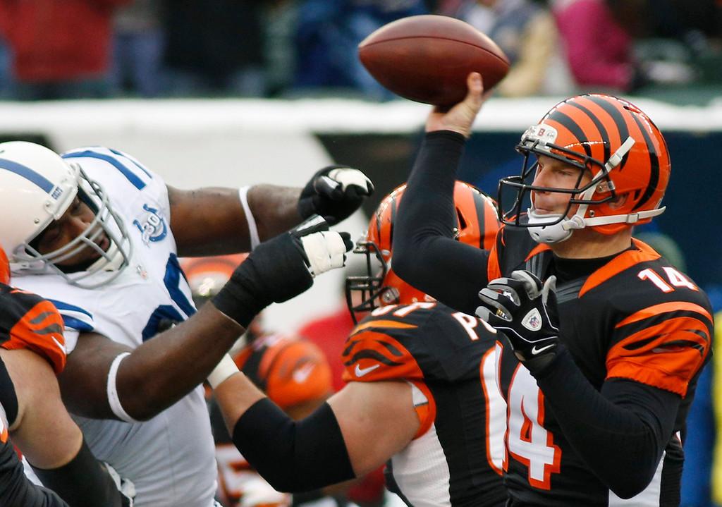 . Cincinnati Bengals quarterback Andy Dalton (14) passes against the Indianapolis Colts in the first half of an NFL football game, Sunday, Dec. 8, 2013, in Cincinnati. (AP Photo/David Kohl)