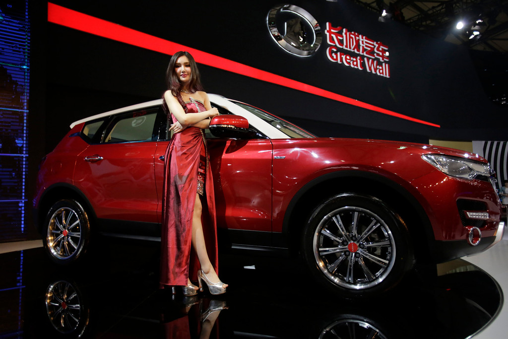 . A model poses with Great Wall H7 SUV at the Shanghai International Automobile Industry Exhibition (AUTO Shanghai) media day in Shanghai, China Saturday, April 20, 2013. China\'s most successful SUV producer, Great Wall Motor Co., is coming out with a model that offers the room of a luxury SUV at a mid-range price. The Chinese brand, which exports SUVs to 80 countries, unveiled the H7 and its sister sport model, the H6, on Saturday ahead of the Shanghai auto show. Great Wall is one exception to the trend of independent Chinese brands struggling against foreign competition in their home market.(AP Photo/Eugene Hoshiko)