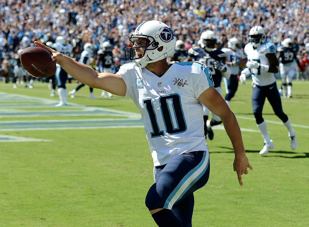 . Tennessee Titans quarterback Jake Locker (10) celebrates as he scores a touchdown on a 7-yard run against the San Diego Chargers in the second quarter of an NFL football game on Sunday, Sept. 22, 2013, in Nashville, Tenn. (AP Photo/Mark Zaleski)