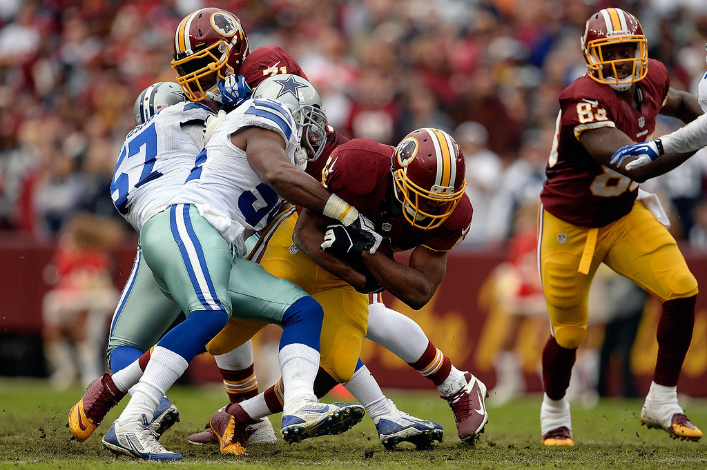 . Alfred Morris #46 of the Washington Redskins carries the ball against the Dallas Cowboys in the first quarter during an NFL game at FedExField on December 22, 2013 in Landover, Maryland.  (Photo by Patrick McDermott/Getty Images)