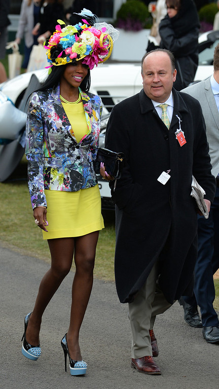 . Racegoers attend Ladies Day, the second day of the Grand National Meeting horse racing event at Aintree Racecourse in Liverpool, north-west England on April 5, 2013. The annual three day meeting culminates in the Grand National which is run over a distance of four miles and four furlongs (7,242 metres), and is the biggest betting race in the United Kingdom.  ANDREW YATES/AFP/Getty Images