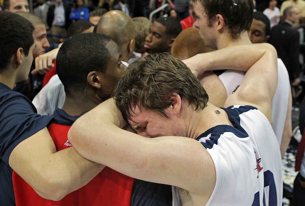 . Metro State guard Mitch McCarron cries on a teammates shoulder after losing to Drury 73-74 in the NCAA Division II National Championship on Sunday, April 7, 2013, in Atlanta.  (AP Photo/ Atlanta Journal-Constitution, Curtis Compton)