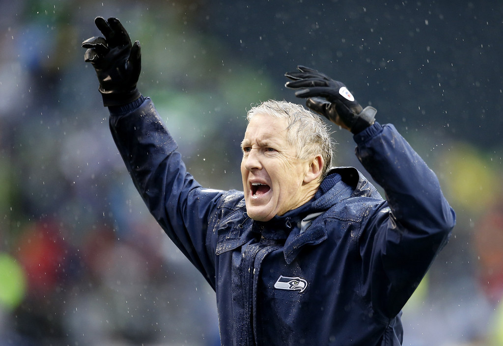 . SEATTLE, WA - JANUARY 11:  Head coach Pete Carroll of the Seattle Seahawks reacts in the first half while taking on the New Orleans Saints during the NFC Divisional Playoff Game at CenturyLink Field on January 11, 2014 in Seattle, Washington.  (Photo by Otto Greule Jr/Getty Images)