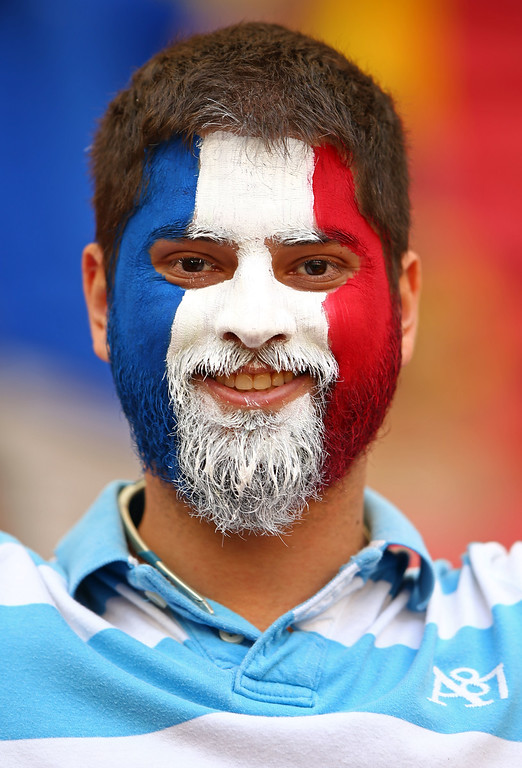 . A France fan enjoys the atmosphere prior to the 2014 FIFA World Cup Brazil Round of 16 match between France and Nigeria at Estadio Nacional on June 30, 2014 in Brasilia, Brazil.  (Photo by Ian Walton/Getty Images)