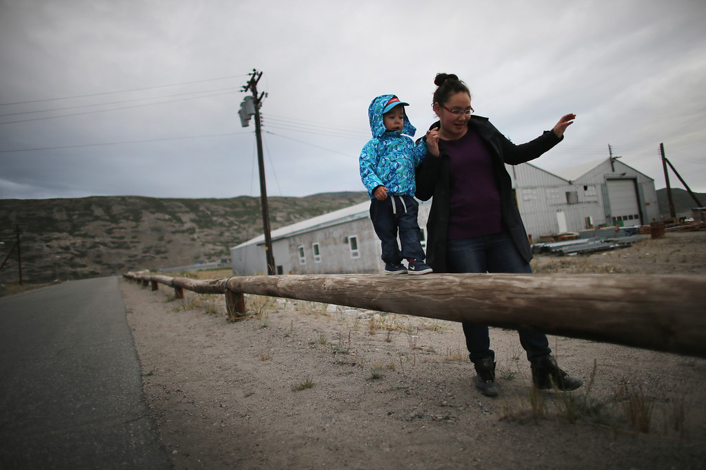 . A mother and child walk together on July 09, 2013 in Kangerlussuaq, Greenland.   (Photo by Joe Raedle/Getty Images)
